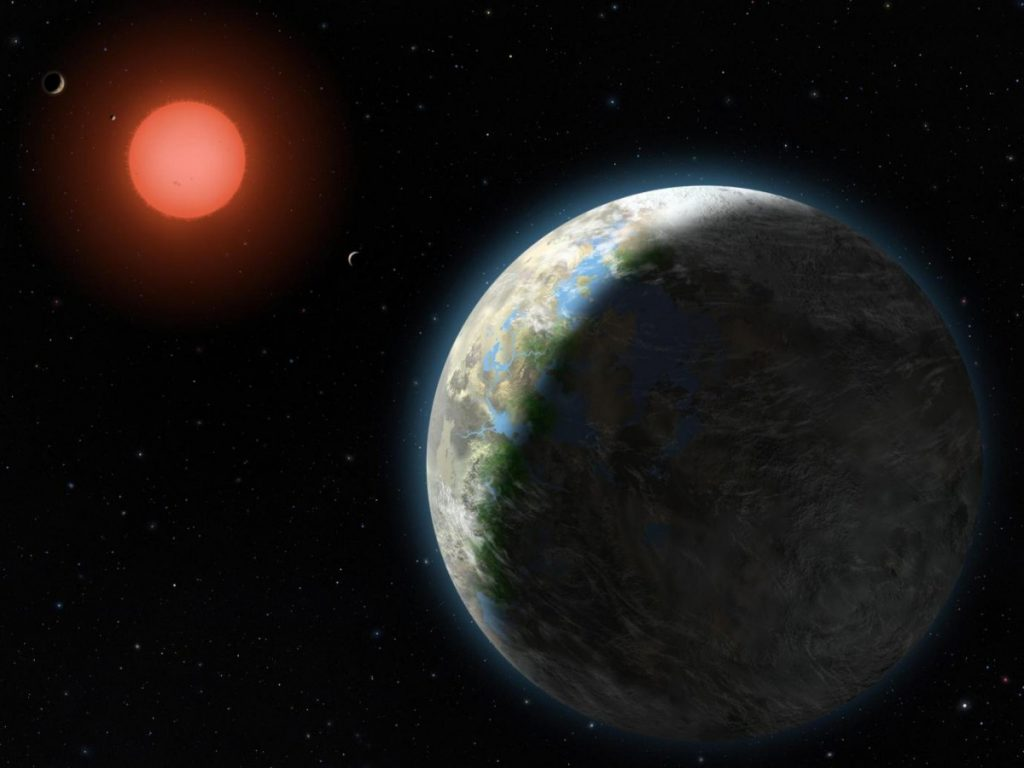 An artist's conception of an exoplanet with clouds and surface water, orbiting a red dwarf star. Credit: University of Chicago