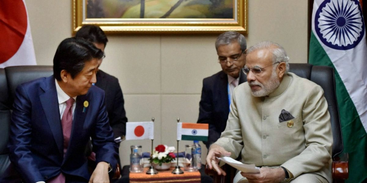 Japan, China strike deals during Abe visit as ties improve