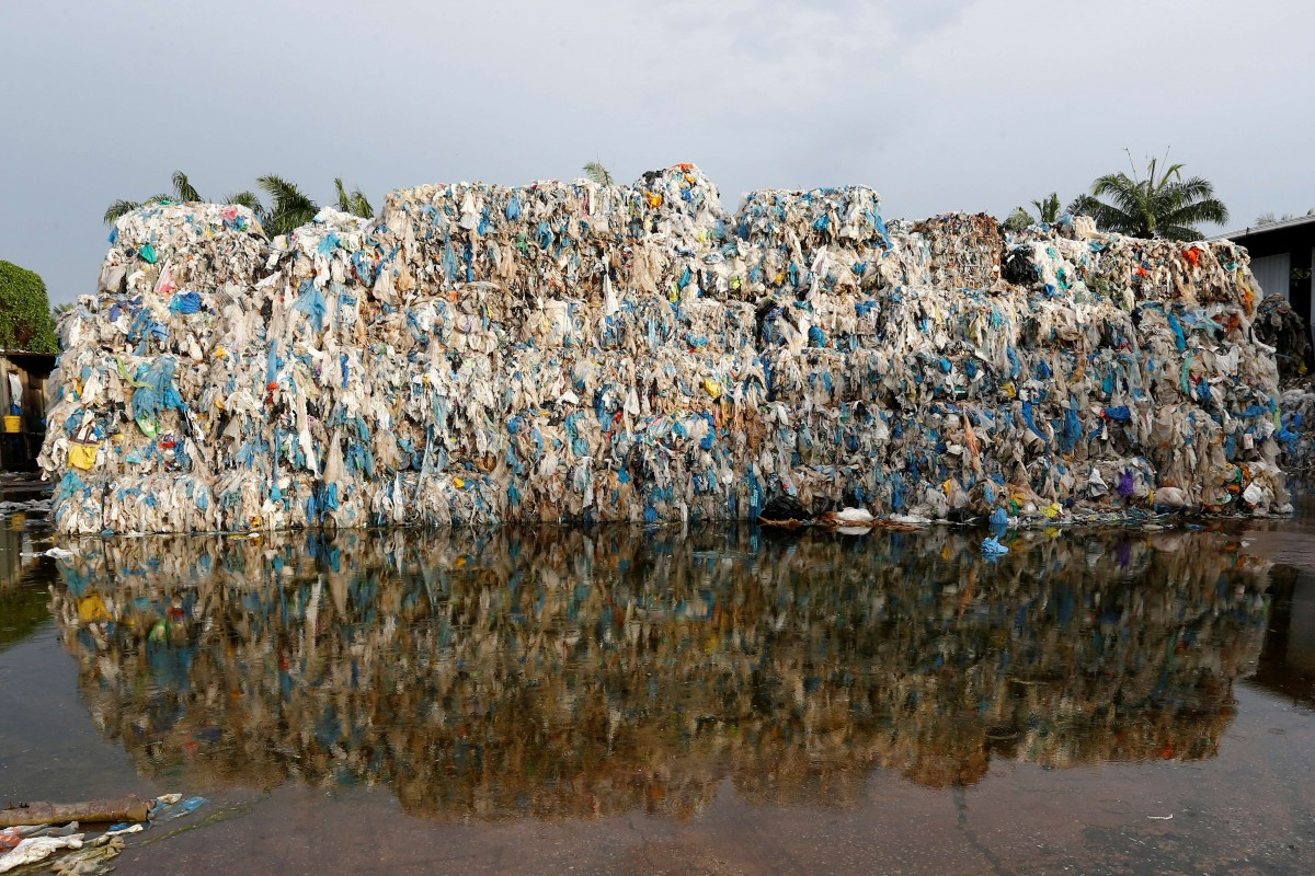 Plastic waste piled outside an illegal recycling factory in Jenjarom, Kuala Langat, Malaysia October 14, 2018. REUTERS/Lai Seng Sin/Files
