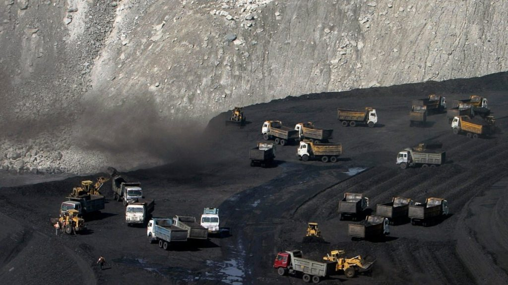 Trucks on a coal reserve in India-Adivasi-Reuters