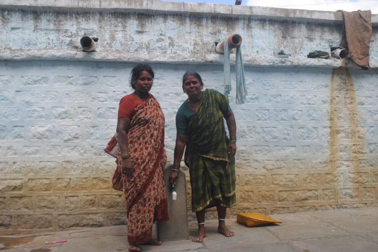 Devamma and Buchamma at Hanwada with the water tap outside their homes. Credit: Meena Menon.