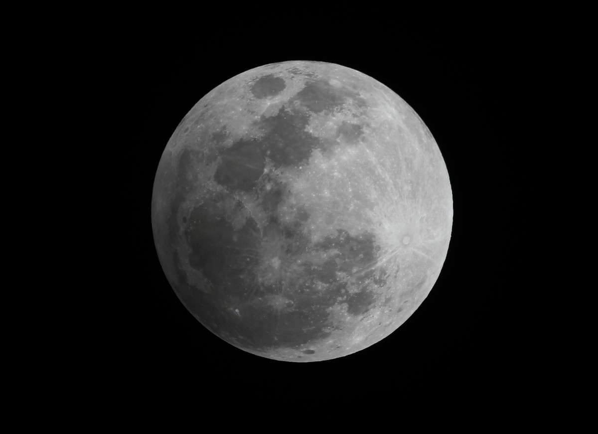 A penumbral eclipse of the moon is seen in the night sky in Manila November 28, 2012. Credit: REUTERS/Romeo Ranoco/Files