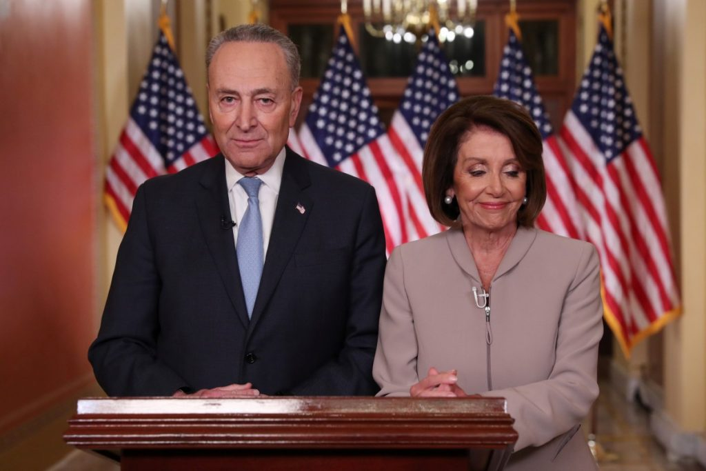 U.S. Speaker of the House Nancy Pelosi and Senate Minority Leader Chuck Schumer pose for photographers after concluding their joint response, to President Trump's prime time address, on Capitol Hill in Washington, US, January 8, 2019. Credit: REUTERS/Jonathan Ernst