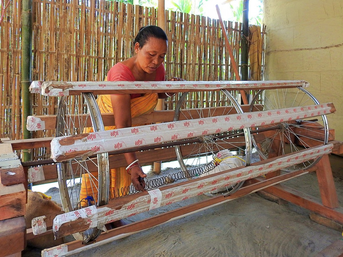 Tinkering with the recently installed warping drum, used to prepare the vertical 'warp' yarn, which is later loaded on the loom. Credit: Anne Pinto-Rodrigues/People's Archive of Rural India