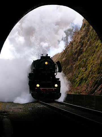 A Deutsche Reichsbahn DR Class 52.80 steam locomotive at the entrance of a tunnel in Eisenach, Germany, 2006. Credit: HeizDampf/German Wikipedia, CC BY-SA 3.0
