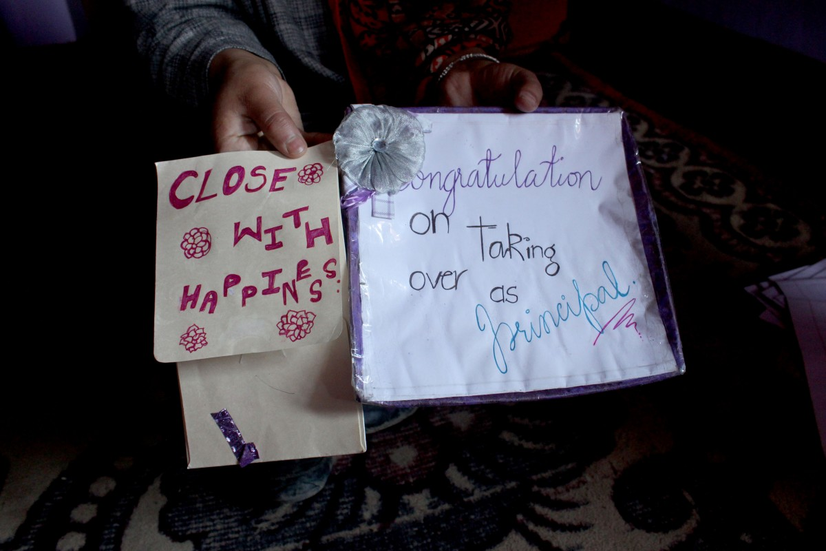 Rizwan's sister showing the gifts he got from his students at several occasions. The gifts include those he got on re-joining his school this January and those sent to him on his birthday on the penultimate day of his life. Credit: Waseem Dar