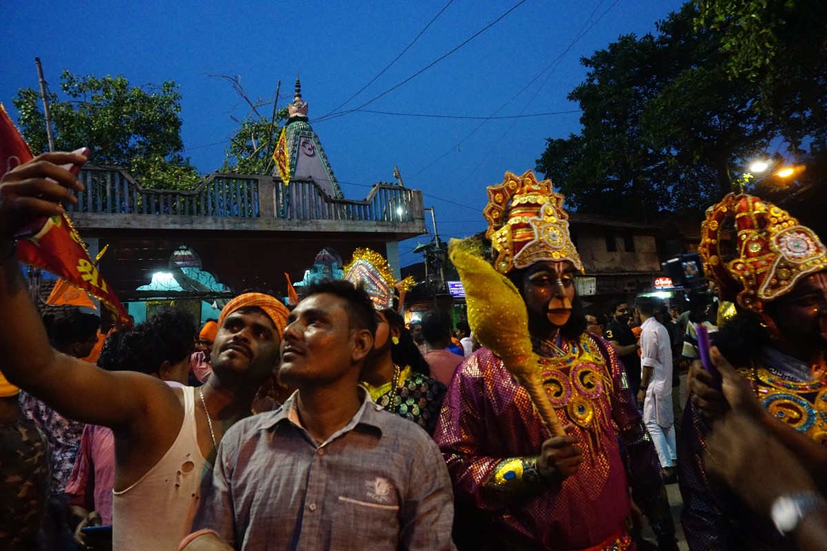 People click a selfie with hanuman at a Ramnavami rally organised by the Trinamool Congress. Credit: Shome Basu