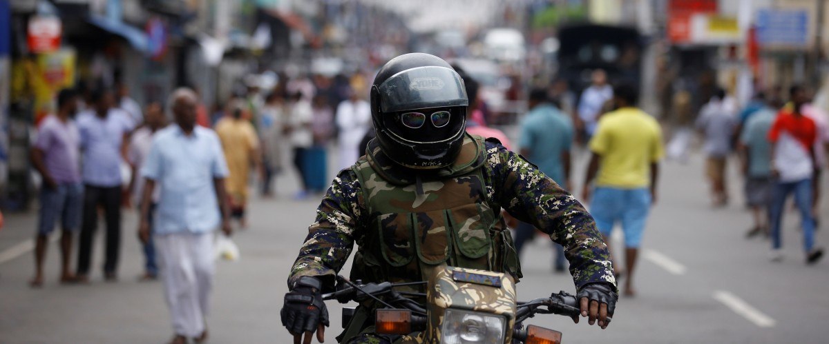 A member of the Sri Lankan security forces sits on a motorbike as he keeps watch outside St Anthony's Shrine, days after a string of suicide bomb attacks across the island on Easter Sunday, in Colombo, Sri Lanka April 28, 2019. Credit: REUTERS/Thomas Peter