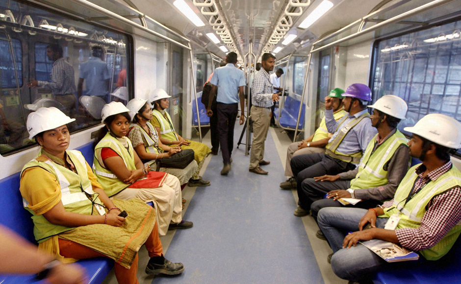 Metro train workers inside a coach during a trial run between Koyambedu and Ashok Nagar in Chennai on Saturday. Credit: PTI