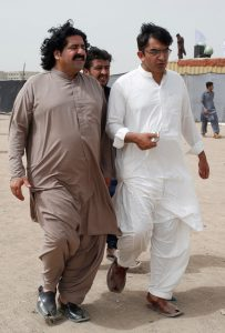 FILE PHOTO: Ali Wazir (L) and Mohsin Dawar, leaders of the Pashtun Tahaffuz Movement (PTM) walks at the venue of a rally against, what they say, are human rights violations by security forces, in Karachi, Pakistan May 13, 2018. Credit: REUTERS/Akhtar Soomro/File Photo