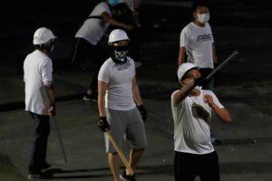 Hong Kong: Masked Men in White Shirts Attack Protestors With Sticks