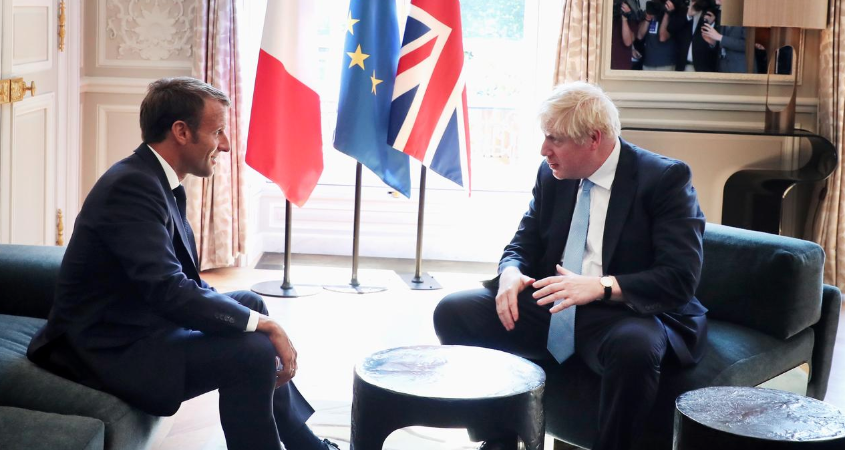 Foot on table: British PM at home in French president palace