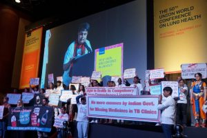 TB Survivors Disrupt Global Conference, Demand That Drugs Be Made Cheaper