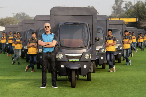 Unpacking the Spectacle of Jeff Bezos Driving an Electric Rickshaw in India