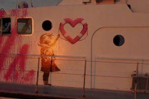 British Street Artist Banksy Funds Refugee Rescue Boat