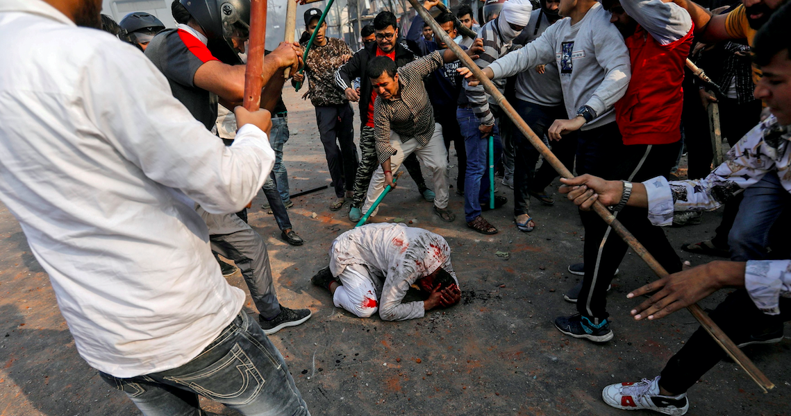 Photo of Muslim Man Being Beaten in Delhi Riots is Reuters' India Pick in 'Pictures of Year' List