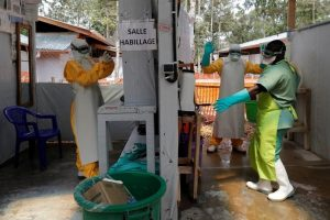 Ebola, COVID-19 and the Moral Injury of Dignity